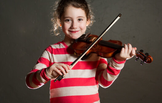 girl in stripped shirt plays a violin