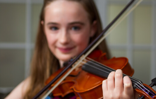 closeup of girl playing a violin